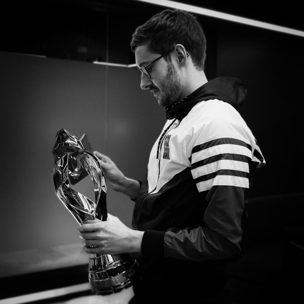 Bjergsen holding the LCS trophy that he is desperate to retain.